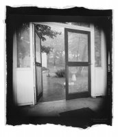 Black and white photo: Through Screen Doors—Lily Dale