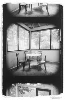 Black and white photo: Table and Chairs Porch—Lily Dale